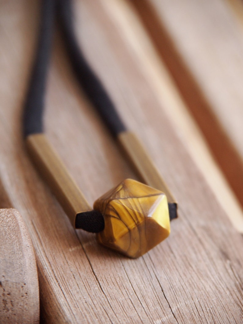 marbled golden brown and brass tube minimalist polyhedron image 0