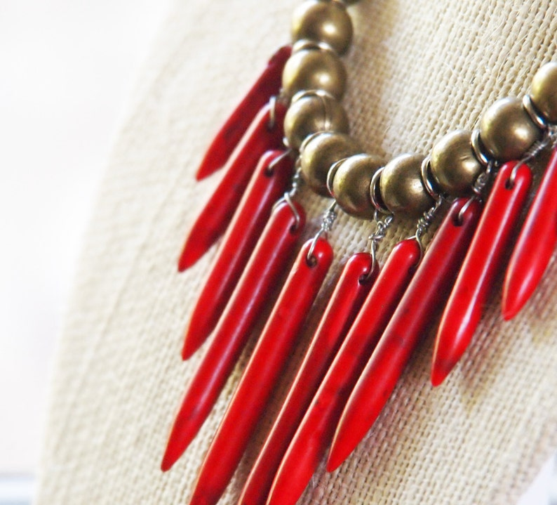 red spiky necklace with brass and grey cotton jersey // red image 0