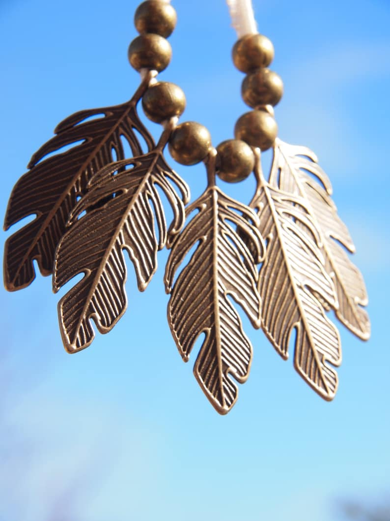 metal feather leafy bronze or copper with ribbed ivory organic image 0