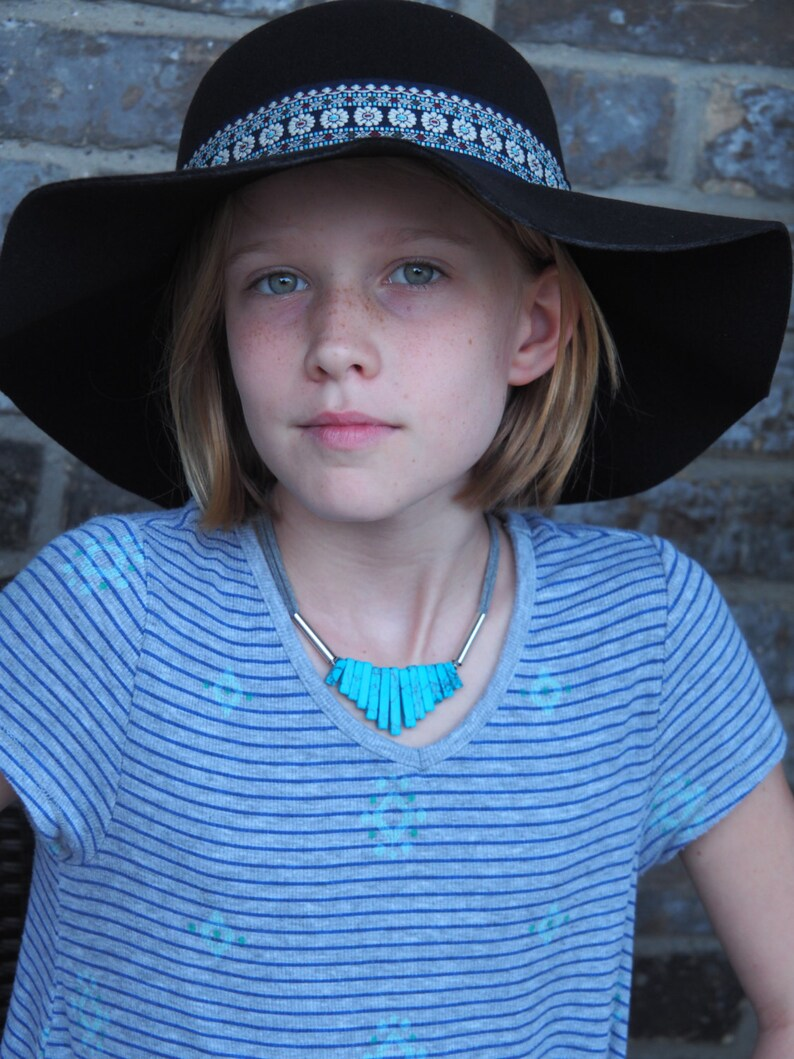 Turquoise graduated necklace with silver and grey cotton image 0