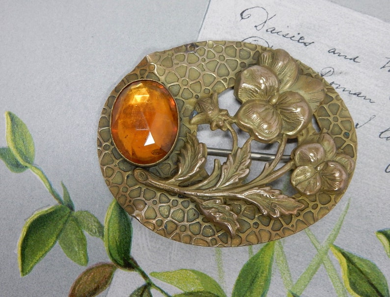 Arts /& Crafts Brooch w Openwork Floral Design and Amber Stone    PBL25