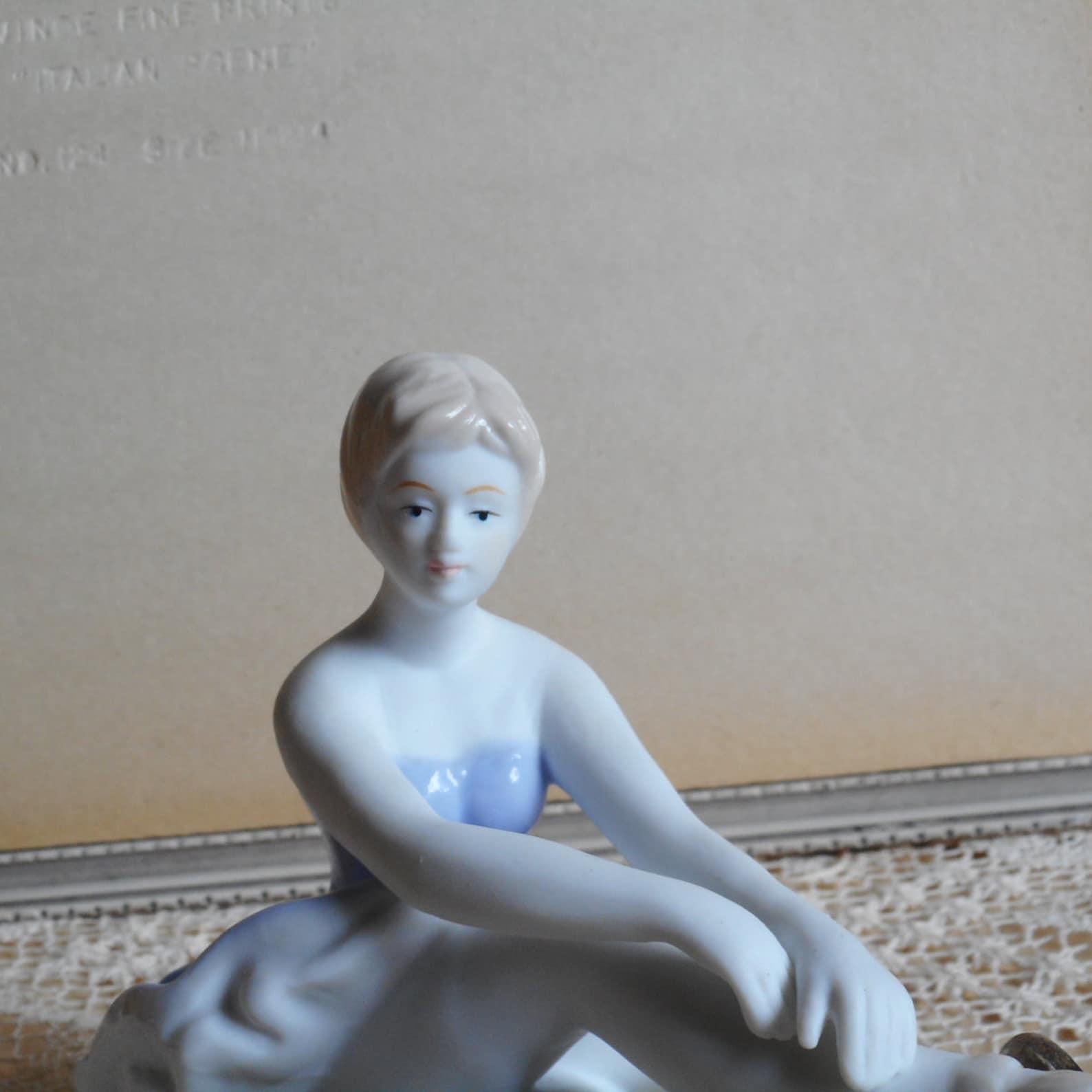 vintage fine porcelain ballerina. very soft blue and white dress. light beige hair and shoes. ballet dancer.