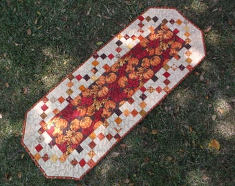 Quilted fall table runner with piano key border