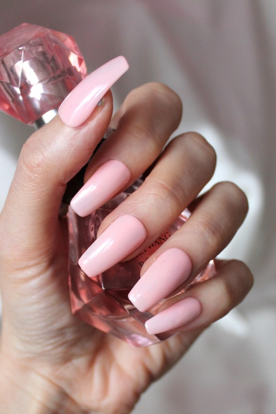 Pink light stiletto nails