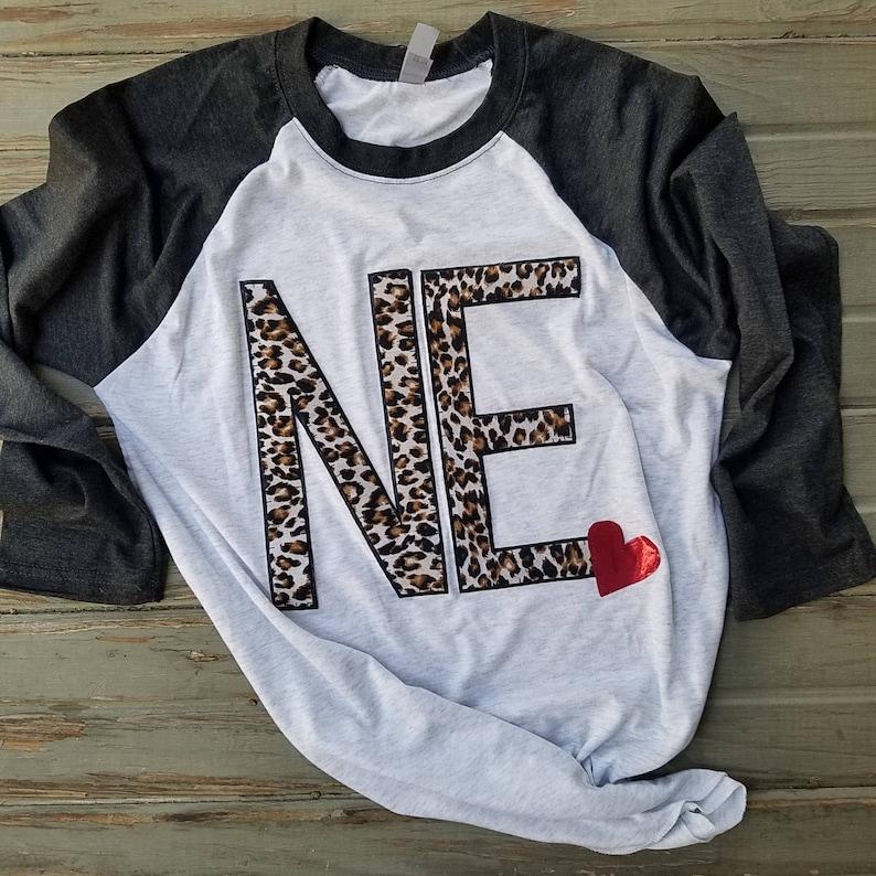 a555144d6 Nebraska abbreviation NE Ne heart women shirt raglan | Etsy