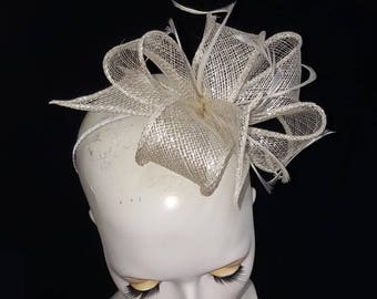 Silver and White sinamay and feather fascinator on headband fixing ideal weddings races