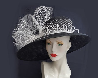 Large black white ascot wedding hat with asymmetrical brim dramatic decoration of veiling and crinoline 22 inch head size