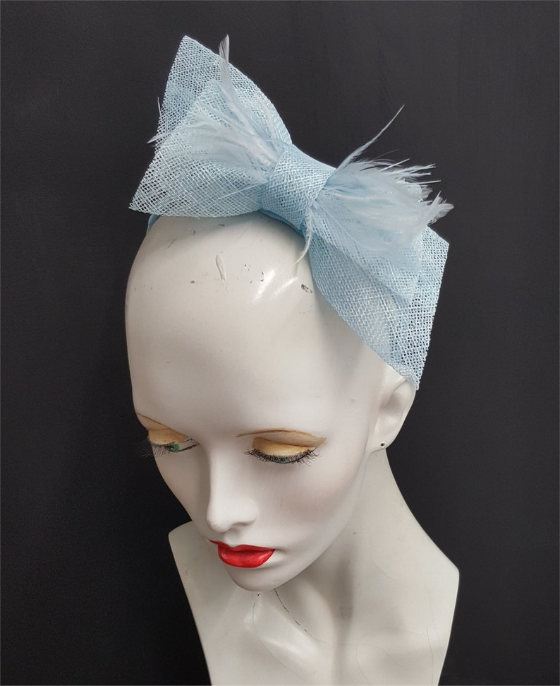 430b6787cba49 Pale blue bow fascinator with feathers sky blue fascinators