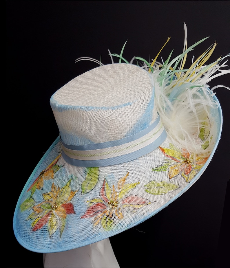 16b3dabb9760a Large white blue yellow green red mother of the bride wedding hat, all hand  painted with flowers and leaves, matching feathers, made in UK