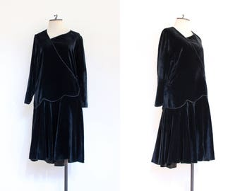 vintage 1920s black velvet long sleeved drop waist dress | 20s gothic soft velvet afternoon dress with asymmetrical waistline | M