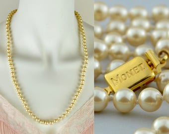 """Faux pearl necklace by Monet matinee length   vintage 1960s 24"""" knotted cream champagne single strand simulated pearls   goldtone box clasp"""
