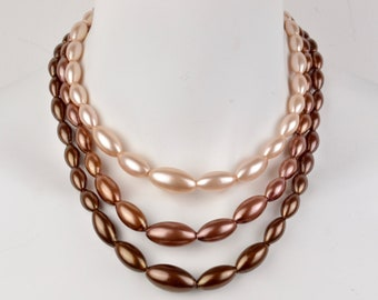 50s-60s triple strand graduated bead champagne brown ombre necklace NOS adjustable Hong Kong stamp faux pearl bib vintage deadstock