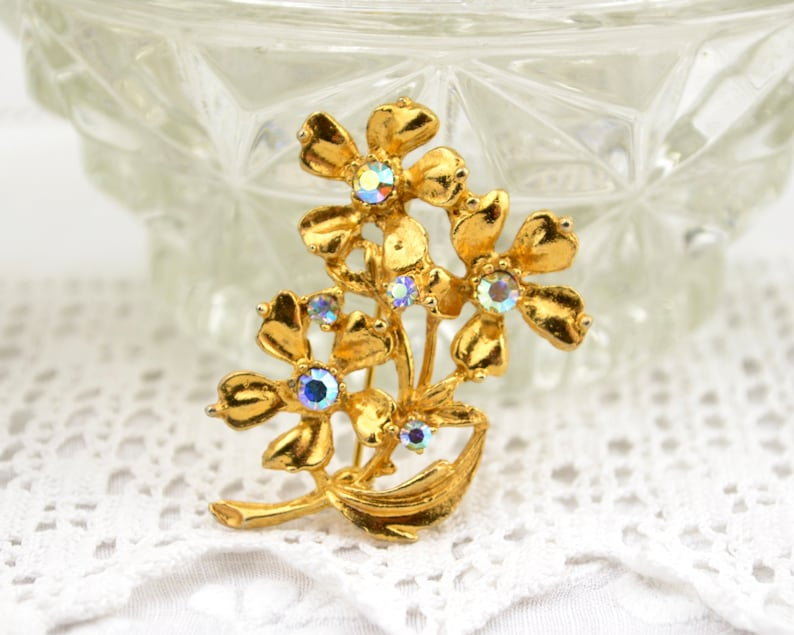Vintage flower brooch 50s 60s  with blue AB rhinestones gold image 0