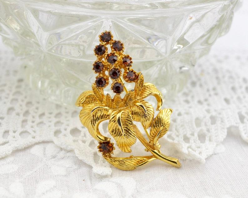 50s 60s exotic flower brooch with dark amber rhinestones  image 0