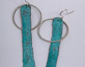 Hammered and oxidized copper and sterling silver drop earrings.
