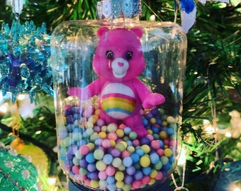 Bear On Package In Pinks Holding her Bear Doll Ceramic Ornament Christmas Ornaments