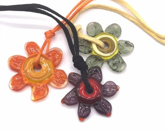 Orange glass flower pendant. Handmade lamp work bead on a silky fabric cord