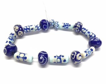 Blue and white glass beads, assorted shapes and patterned handmade glass beads. Cylinders and round, speckles, spots and curls