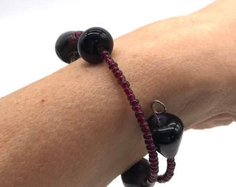 Mauve glass bead bangle bracelet. Five handmade glass beads with plum colour seed beads on a memory wire