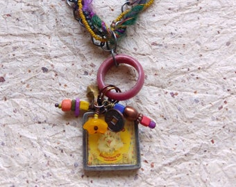 CLOWN BRAND trinket necklace with vintage trade beads, gemstones, artwork pendant and sari silk fibers