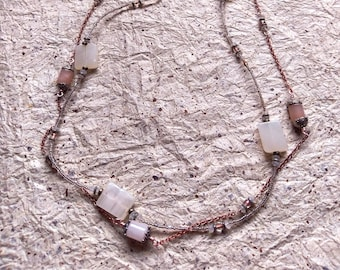 Blank Tablet and Closed Capsules: necklace pair with marvelous magical stones