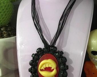 Vampire teeth skull necklace
