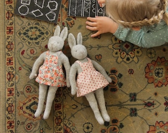 Hattie bunny rabbit softie doll toy collectible natural toy wool from Out of the Thistle with flower pinafore dress knitted seamless