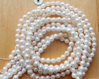 6mm White faceted  potato freshwater pearls. FULL STRAND (16 inches)