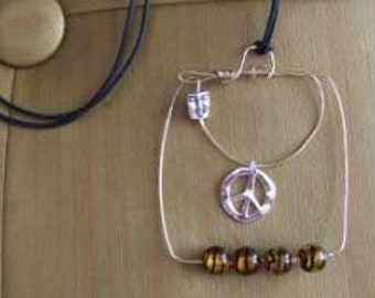The face of Peace Necklace!  Make Art not war! Twenty inches of peace can cover the world!