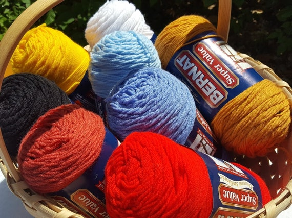 8 skeins of Bernat Super Value yarn in assorted colors