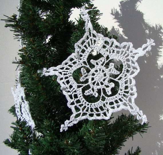 Crocheted white sparkle snowflakes