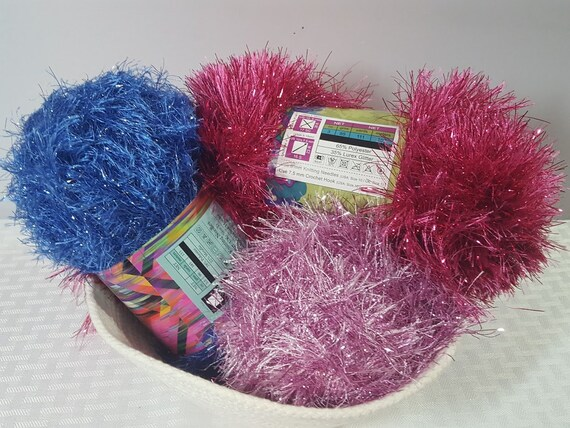 3 skeins of eyelash yarn in brilliant blue, raspberry and pink