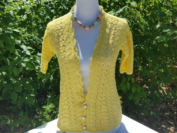 Sunflower Yellow crocheted short-sleeve cardigan with open work design and scalloped edging