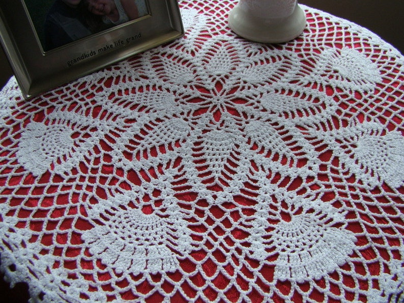 White kaleidoscope and pinwheel crochet table topper doily