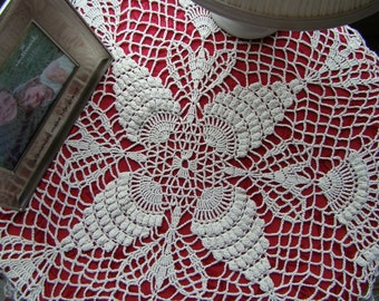 Crochet table topper doily in tan beige with pineapple puff stitching