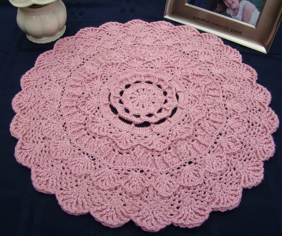 Dusty pink rose textured crocheted doily with scallop edging and three-dimensional design