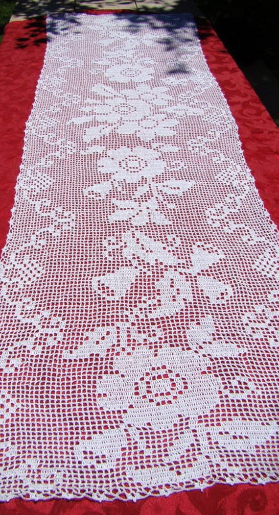 White filet crocheted table runner with primroses and bluebells