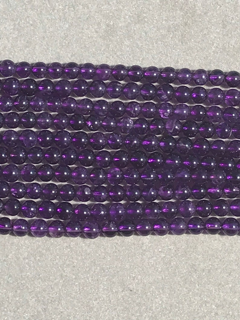 8mm Natural Amethyst Round Faceted 15.5\u201d Strand