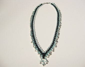 Beadwork necklace using modified St. Petersbury stitch, with turquoise, white, silver and black beads