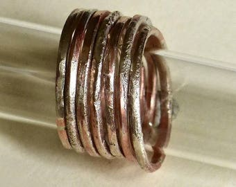 Seven copper and silver staking rings.  Made to order