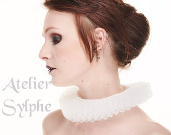 White fantasy ruffle neck elizabethan collar with delicate soft horsehair style back closure on satin neck band