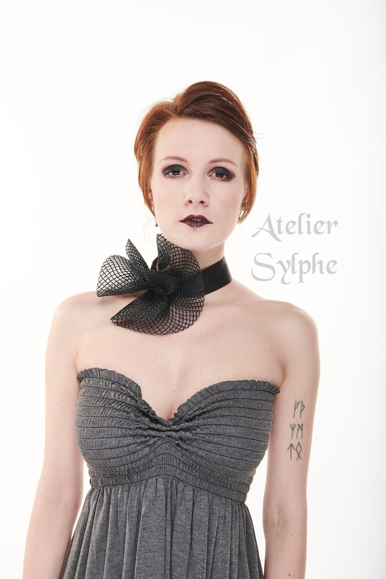 Black fantasy ruffle neck asymmetric collar with delicate soft horsehair style back closure on elastic neck band