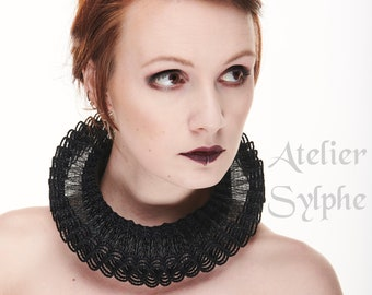 Black fantasy ruffle neck elizabethan collar with delicate soft horsehair style back closure on satin neck band