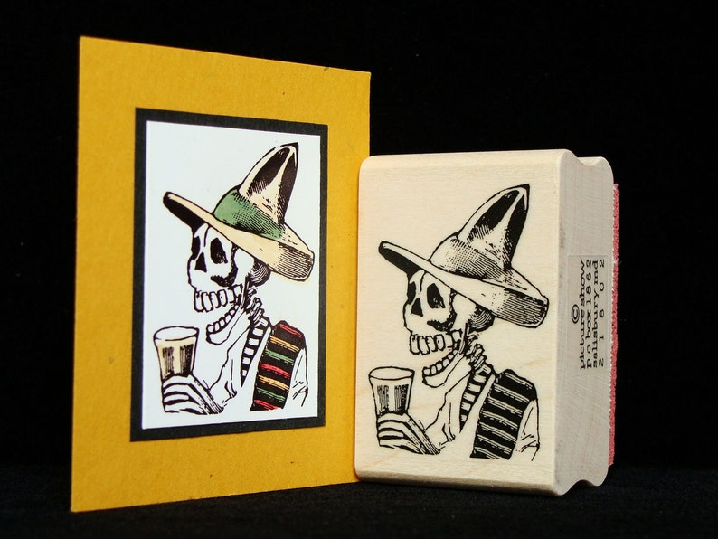 halloween rubber stamp  skeleton with a drink image 0