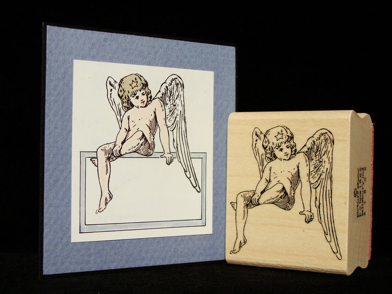 seated angel image 0