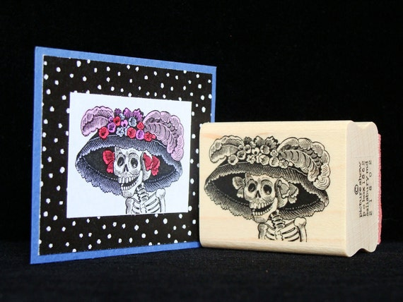 lady skeleton with hat