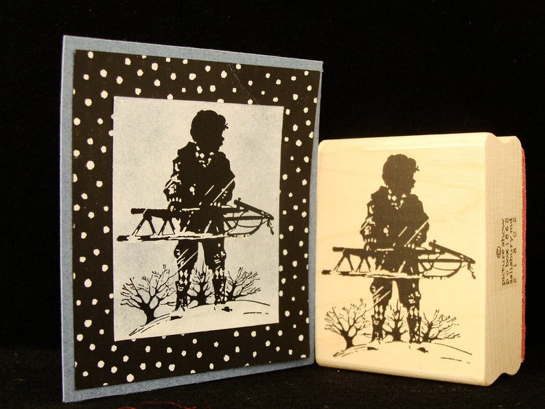 boy with a sled image 0