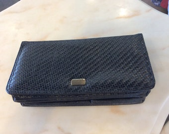 Vintage...Clutch...Made by Goldco...weave black material..clip close...flap over