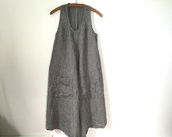 made to order flowing a-line gray and white striped linen dress with pockets racer back and shirt tail hem