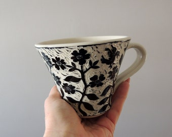 Porcelain Cup with Black and White Hand Carved Birds and Flowers